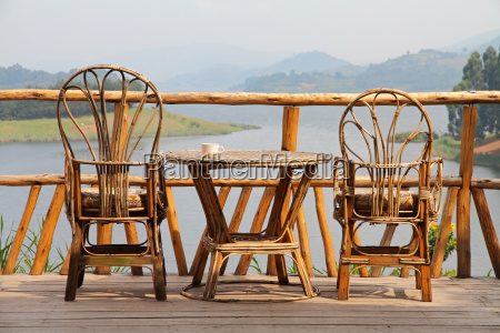 wicker deck chairs with coffee on