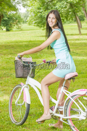 young woman ride bicycle