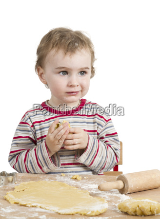 happy young child with rolling pin