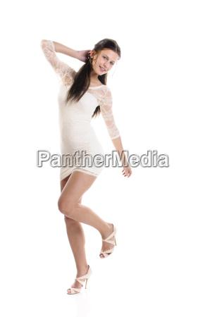 girl in white dress dancing