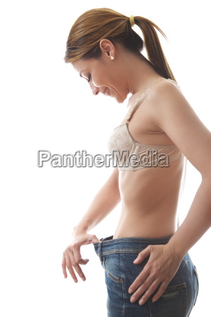 woman looking at loose fitting cloth