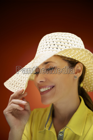 pretty woman with straw hat smiling