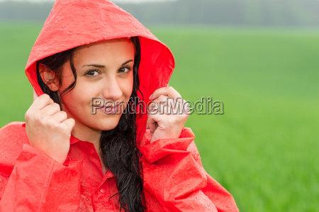 adolescent girl in the rain in