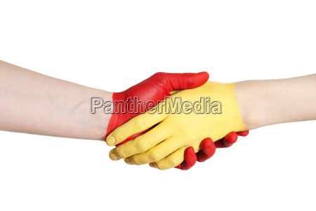 yellow red handshake