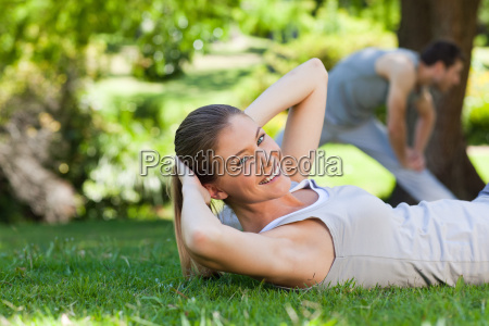 couple doing their stretches in the