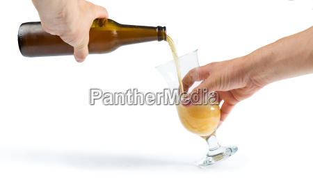 hand holding bottle of beer and
