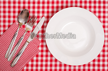 white plates and cutlery