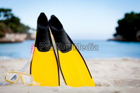 yellow flippers and snorkel mask in