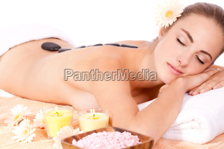 young woman relaxing in spa hot