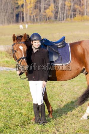 equestrian on horseback in autumnal nature