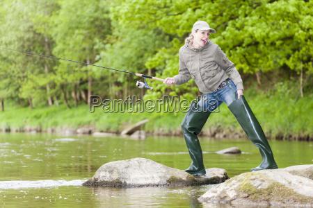 woman fishing in sazava river czech
