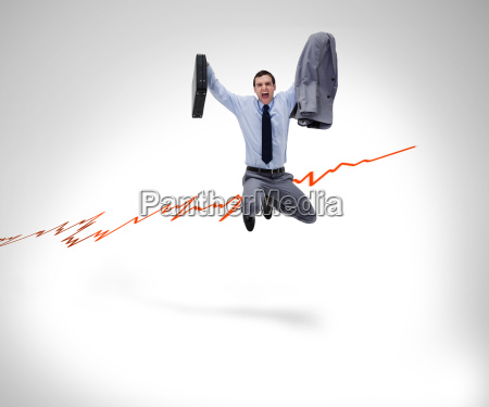 successful businessman jumping before graphical presentation