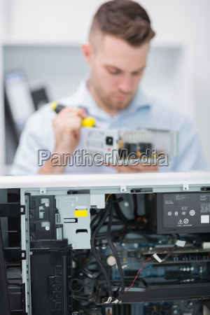 computer engineer working on cpu part