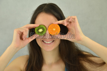 beautiful young girl is holding tangerine