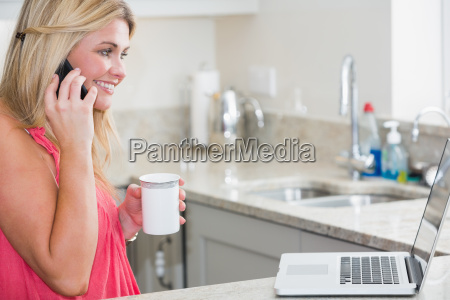 happy woman with laptop and coffee