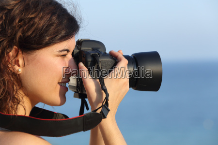 attractive woman taking a photograph with