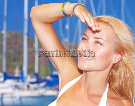 pretty girl in yacht harbor