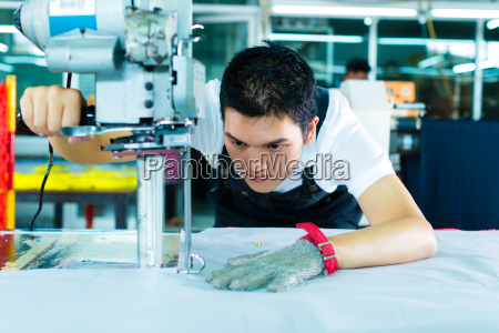 factory, workers, at, a, machine, in - 9603346