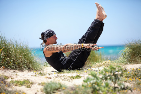 adult man in pilates outdoors in