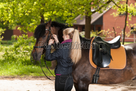 girl sits her horse