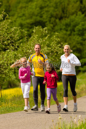 family jogging as sport in nature