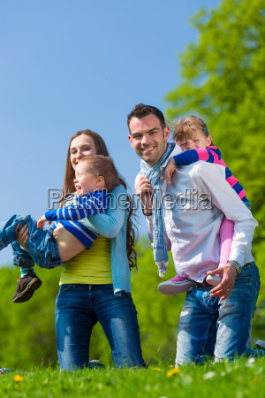 happy family walking on summer meadow