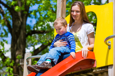 mother and son on a slide