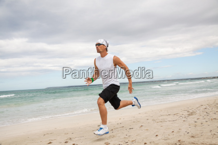 adult athletic man jogging on the