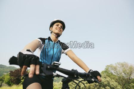 young woman training on mountain bike