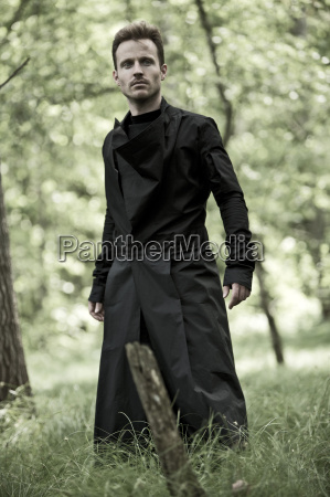 man with black long coat in