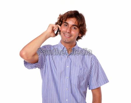 latin man smiling while talking on