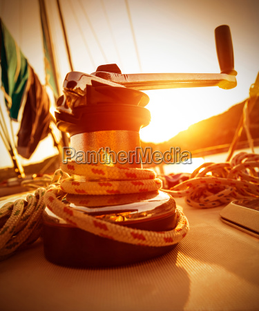 crank handle of yacht on sunset