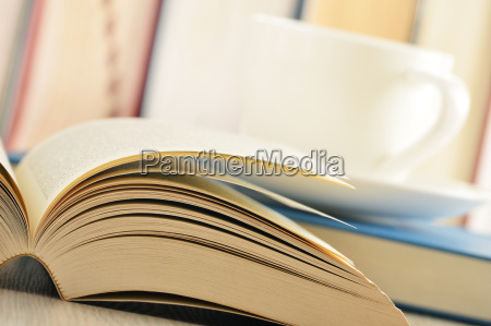 composition with books and cup of