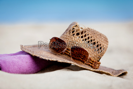 sun protection on holiday straw hat