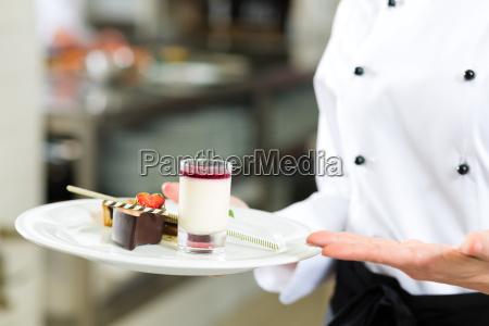 cook pastry chef in restaurant kitchen