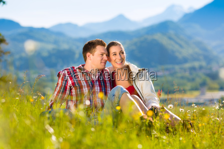 couple in front of mountain panorama