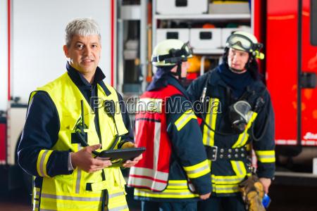 firemen use planning on tablet