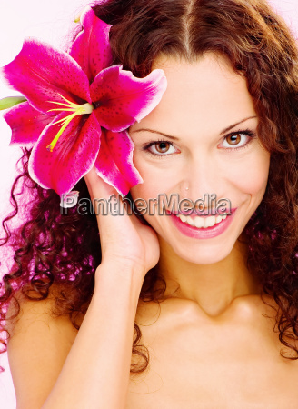 woman with flower in her curl