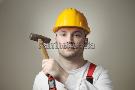 young worker with hammer
