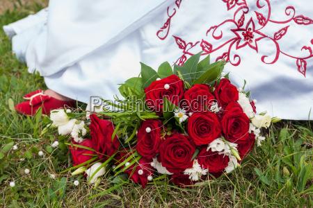 bridal bouquet and bridal shoe