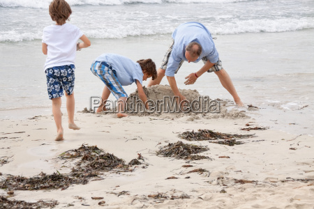 lone father with sons children playing