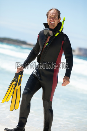 teenage diving with fins and a