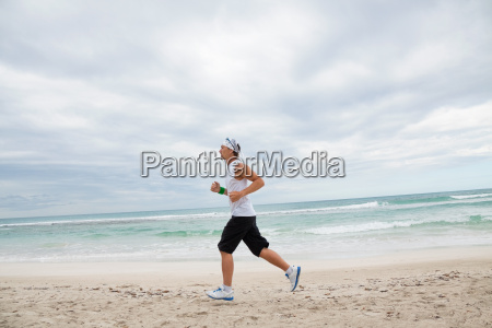 adult sporty man jogging on the
