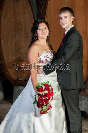 newlyweds in the wine cellar