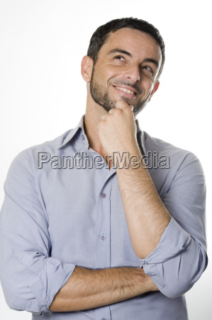 happy young man with beard thinking