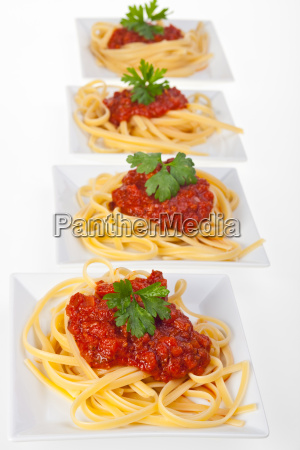 spaghetti with tomato sauce and parsley