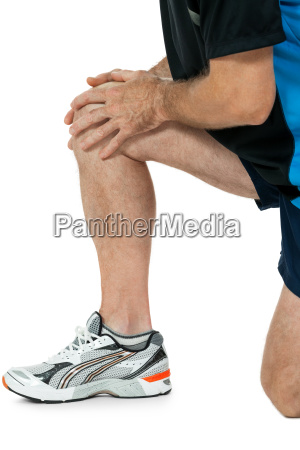 adult athletic man with knee problems