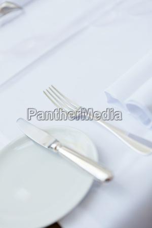 laid restaurant table napkin glasses cutlery