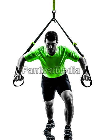 man exercising suspension training trx