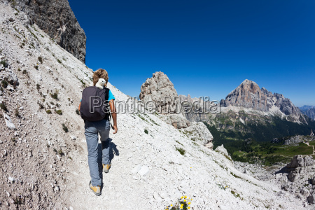 young hiker walking on a mountain